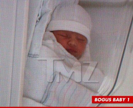 0624-kim-kardashian-kanye-west-baby-bogus-article-tmz-article-4.jpg