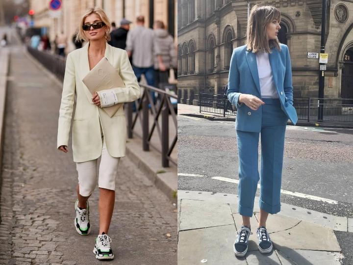 Dos mujeres caminando en la calle usando traje sastre y tenis